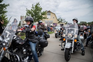 Senator Joni Ernst and Wisconsin Governor Scott Walker on motorcycles as they begin a short ride to Boone for Ernst's inaugural Roast and Ride. 6/6/2015 Photo by Clay Masters