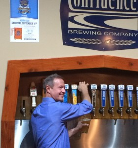 Democratic presidential candidate Martin O'Malley fills a pint at Confluence Brewery Company in Des Moines on Saturday. Photo by Bri Steirer