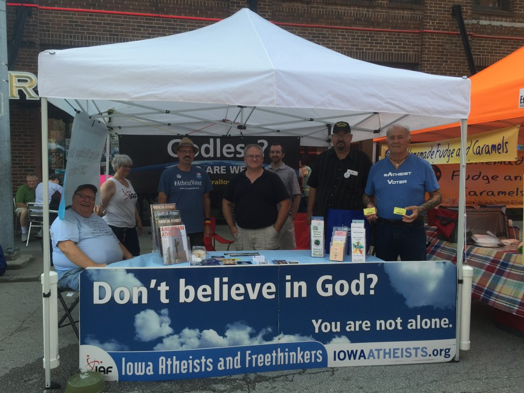 The Iowa Atheists and Freethinkers booth at the Des Moines Farmers Market Saturday. Photo by Haley Barbour.