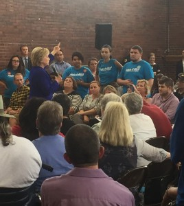 Three Make It Work advocates waiting to ask Hillary Clinton a question on Sep 22. Photo by Haley Barbour.