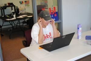 Bush volunteer makes a call. Photo by Skylar Borchardt.