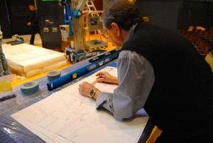 Scenic Designer Joe Tenga measures debate blueprints Photo by Skylar Borchardt