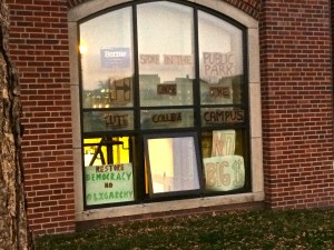 """Residence Hall Window at Grinnell College """"Bernie spoke in the Public Park, Hillary chose the elite college campus"""" Photo by Skylar Borchardt"""