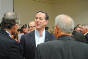Rick Santorum mingles with members of the Iowa Cattlemen's Association. Photo by Skylar Borchardt