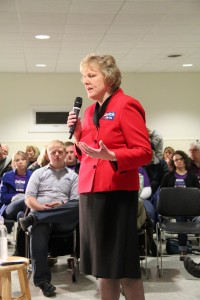 Iowa State Rep. Mary Ann Hanusa (R) introducing John Kasich, whom she endorsed in July, at a town hall in Ankeny. Photo by Katie Ramsey.