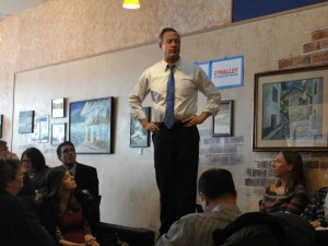 Democratic presidential candidate Martin O'Malley stands on a chair at Uncle Nancy's Coffee House in Newton.